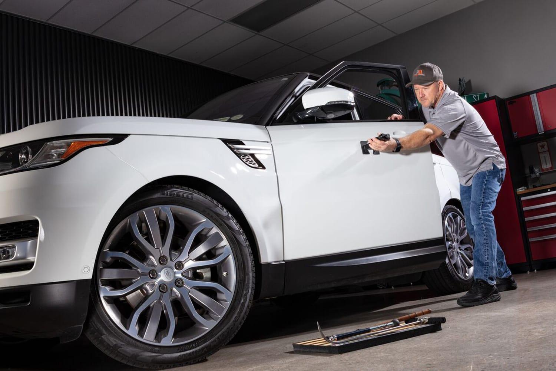 Kent Taylor repairs a vehicle.